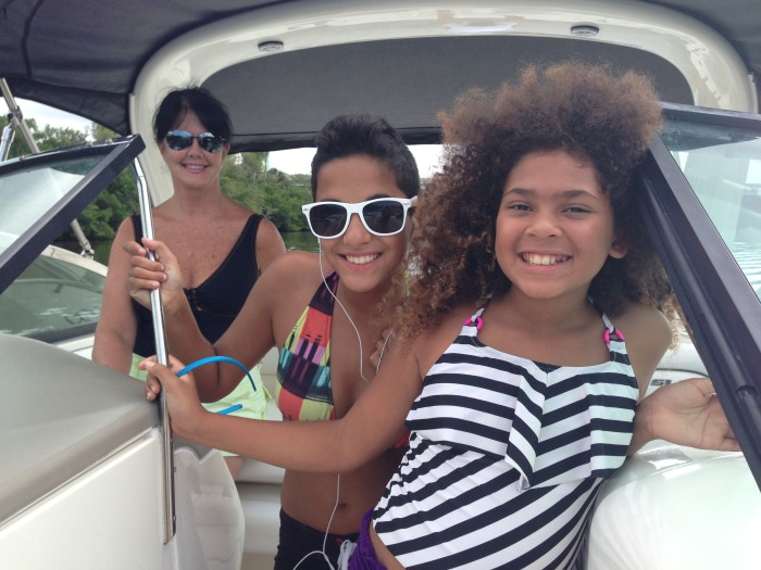 Jessica Seldin's two daughters enjoy a boat ride with their grandmother, Seldin's mom.