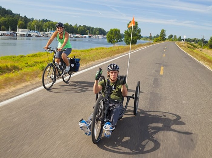 Seth McBride, 30, and his partner, Kelly Schwan, 32, pictured here on Sauvie Island, Oregon, have embarked on a yearlong, 10,000-mile ride from Portland, Ore., to Argentina.