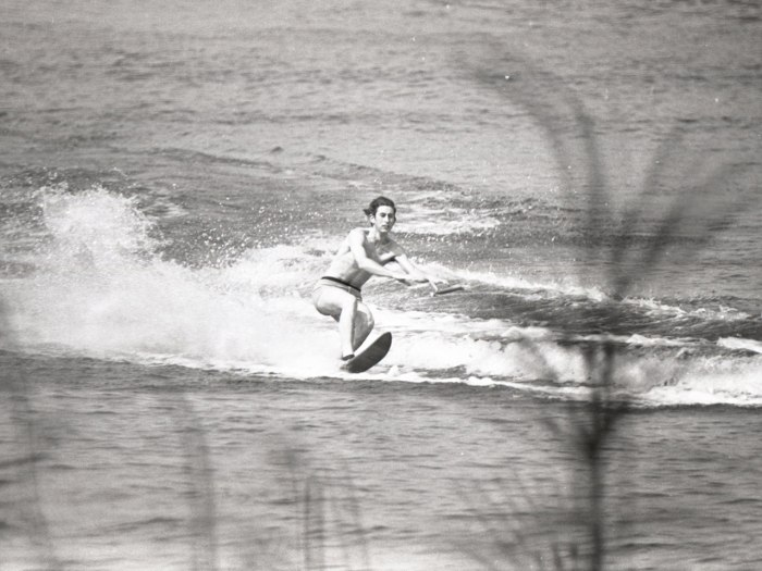 Prince Charles waterskiing on a chair in Sunninghill Park in 1970.