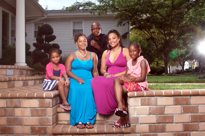 Genelle Guzman-McMillan August 07, 2011 was the last person to be pulled alive from the World Trade Center rubble In Manhattan New York.  Pictured here with husband Roger and daughters Kimberly (22) Kaydi (7) and Kellie (5) in their home in Valley Stream, Long island, New York.