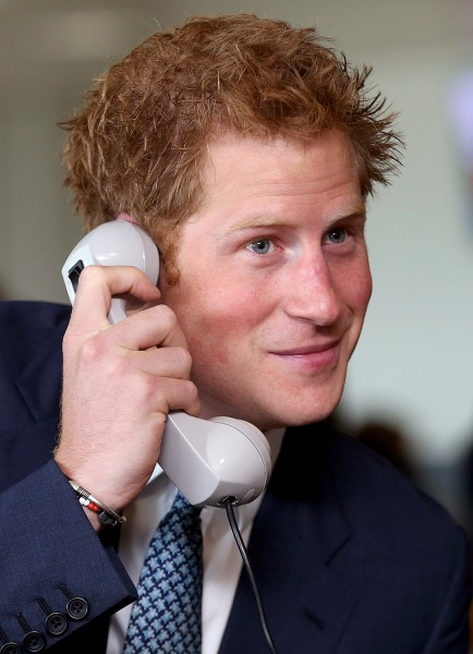 Britain's Prince Harry takes part in a trade on the trading floor of BGC Partners in London September 11, 2013. The company, formerly part of Cantor F...