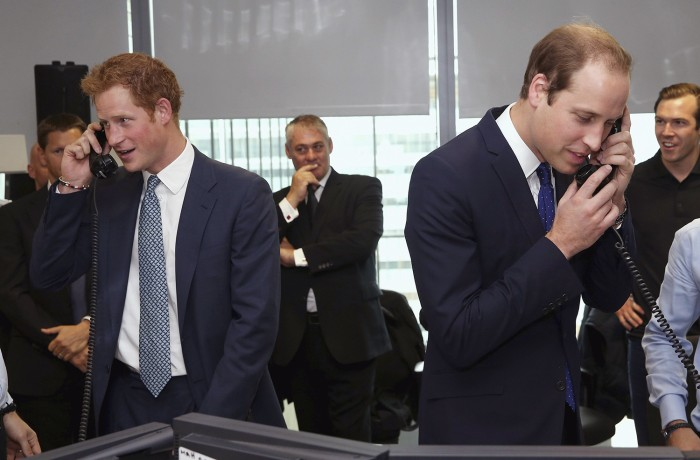 Britain's Prince Harry (L) and Prince William (R) take part in a trade on the trading floor of BGC Partners in London September 11, 2013. The company,...