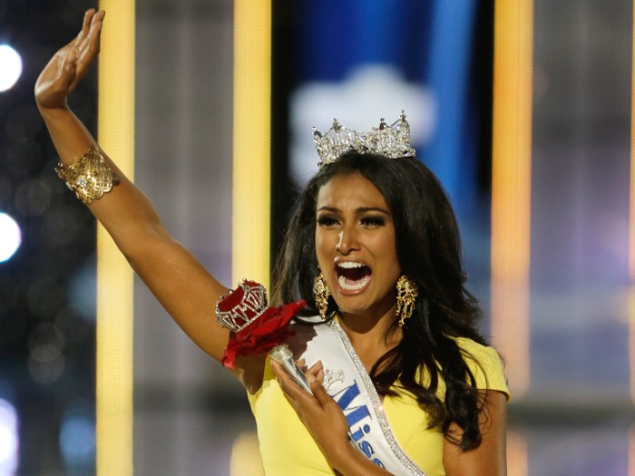 Miss New York Nina Davuluri walks down the runway after winning the the Miss America 2014 pageant, Sunday, Sept. 15, 2013, in Atlantic City, N.J. (AP ...