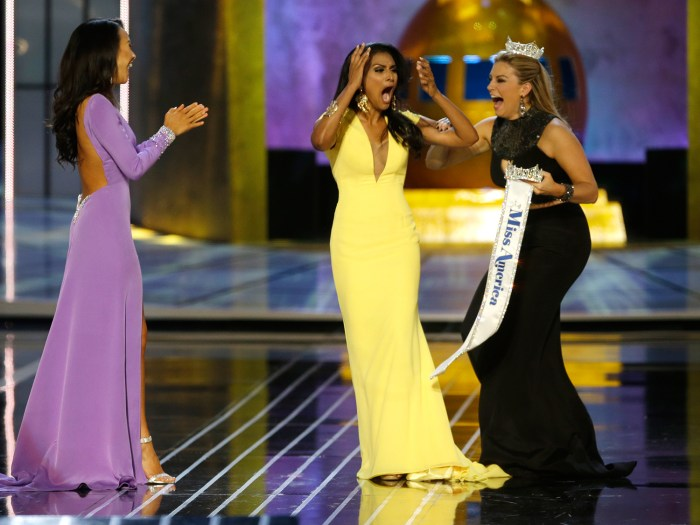 Miss New York Nina Davuluri, center, reacts after being named Miss America 2014 pageant as Miss California Crystal Lee, left, and Miss America 2013 Ma...