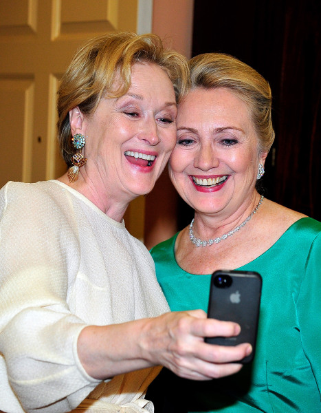 Meryl Streep takes a selfie with then Secretary of State Hillary Clinton following a dinner for Kennedy honorees.