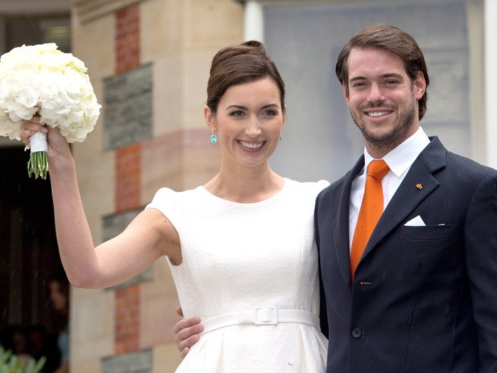Prince Felix of Luxembourg (R) and his wife Claire Lademacher (L) pose for photographs after their civil wedding ceremony.