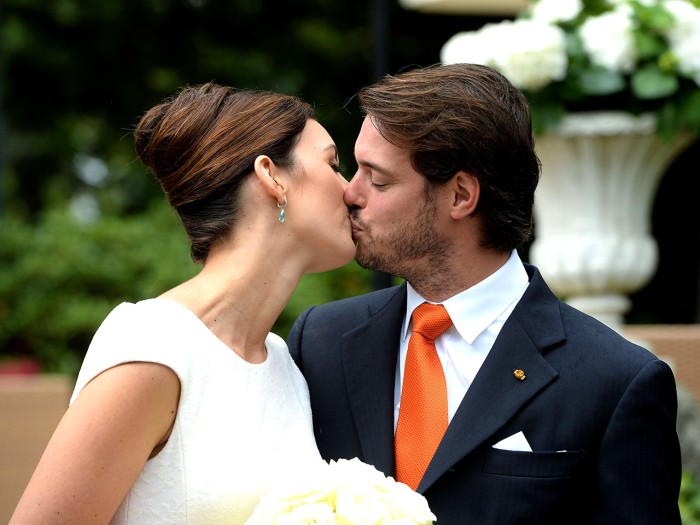 Prince Felix of Luxembourg (R) and German student Claire Lademacher kiss while posing for pictures after their Civil Wedding Ceremony at Villa Rothsch...