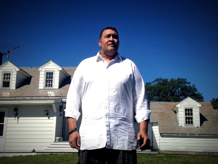 Former NFL lineman Brian Holloway stands outside the New York vacation home trashed by partygoers who invaded his home.