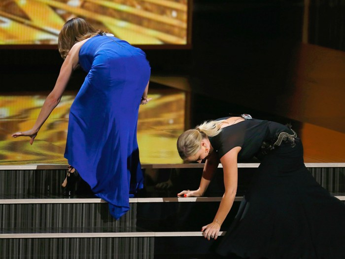 Is this the end? We hope not. Tina Fey and Amy Poehler take a funny tumble on the way to the stage at the Primetime Emmys.