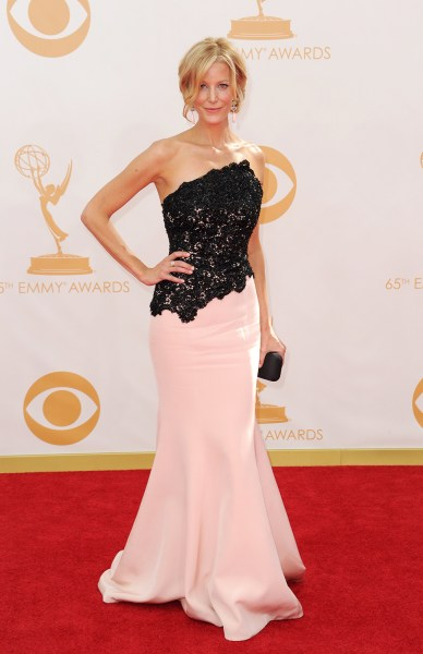 Actress Anna Gunn arrives on the red carpet for the 65th Emmy Awards in Los Angeles on September 22, 2013.  AFP PHOTO / Robyn BeckROBYN BECK/AFP/Getty...