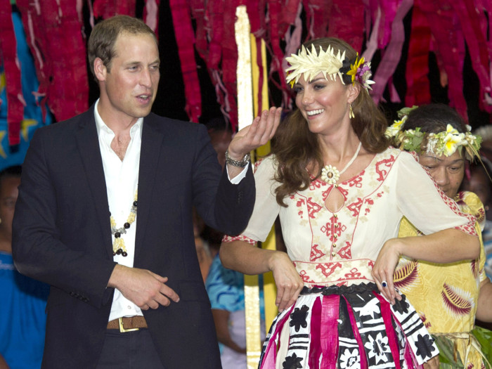 TUVALU - SEPTEMBER 18: Prince William, Duke of Cambridge and Catherine, Duchess of Cambridge dance with the ladies at the Vaiku Falekaupule for an ent...