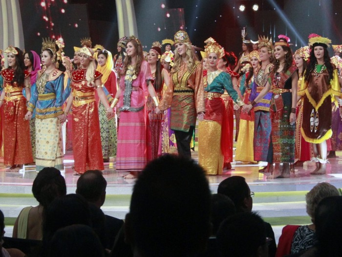 In this Sunday, Sept. 8, 2013 photo, contestants wear traditional Indonesian outfits during the opening ceremony of Miss World 2013 pageant in Nusa Dua, Bali, Indonesia.