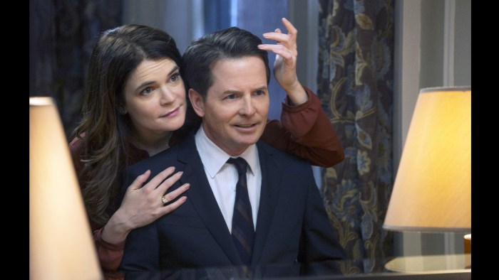 "This image released by NBC shows Betsy Brandt as Annie Henry, left, and Michael J. Fox as Mike Henry in ""The Michael J. Fox Show,"" premiering Sept. 26..."