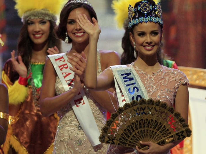 Newly crowned Miss World Megan Young of Philippine, centre, waves, after winning the Miss World contest,  in Nusa Dua, Bali, Indonesia, Saturday, Sept...