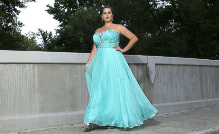 A woman models a plus-size prom dress from Sydney's Closet.