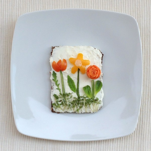 Image: Vegetable flowers on a bed of bread.