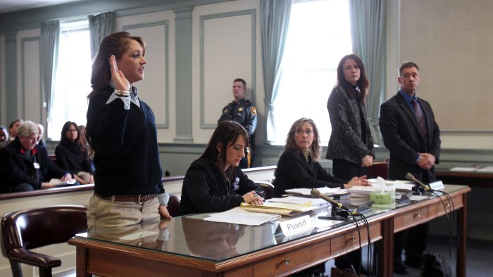 High school student Rachel Canning, 18, left, takes the oath in court as her parents, Elizabeth and Sean, look on in Morris County Superior Court in M...