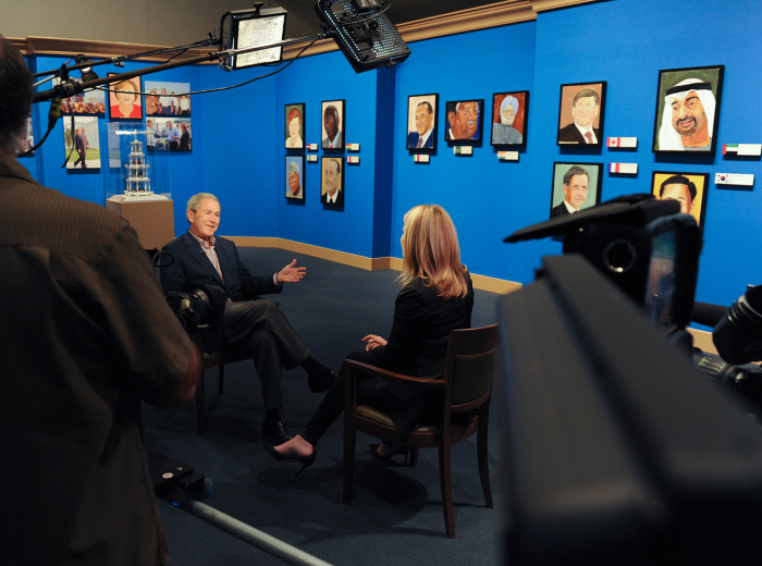President George W. Bush chats with daughter Jenna Bush Hager in Dallas, Texas. Photo by Grant Miller