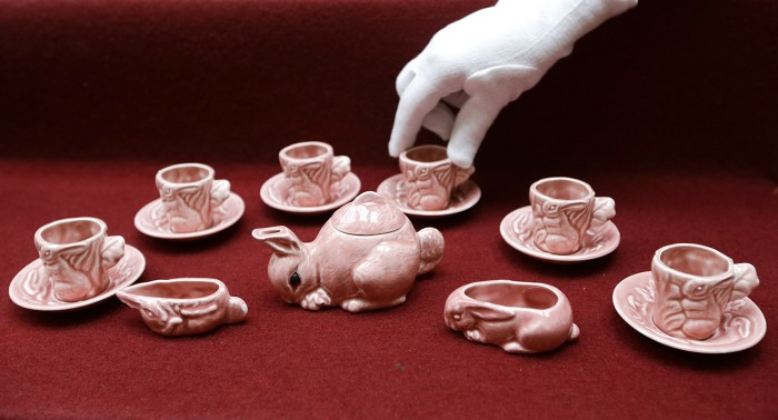 A pink tea set in the shape of a rabbit is displayed at Buckingham Palace in London, Wednesday, April 2, 2014. The tea set, a childhood toy of Britain...