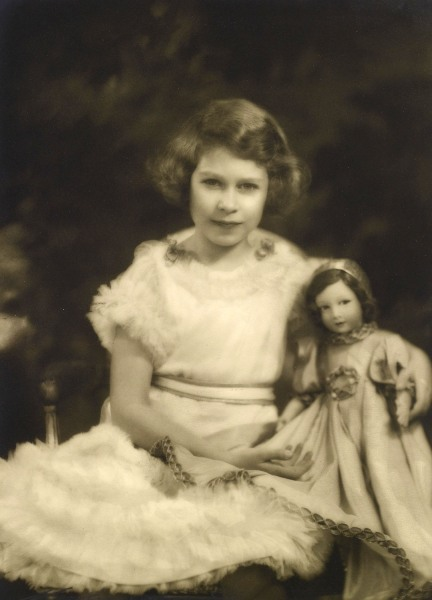 Princess Elizabeth with a Parisian doll, photographed by Marcus Adams.  <br/> <br/>Royal Collection Trust / (C) Her Majesty Queen Elizabeth II 2014.  ...