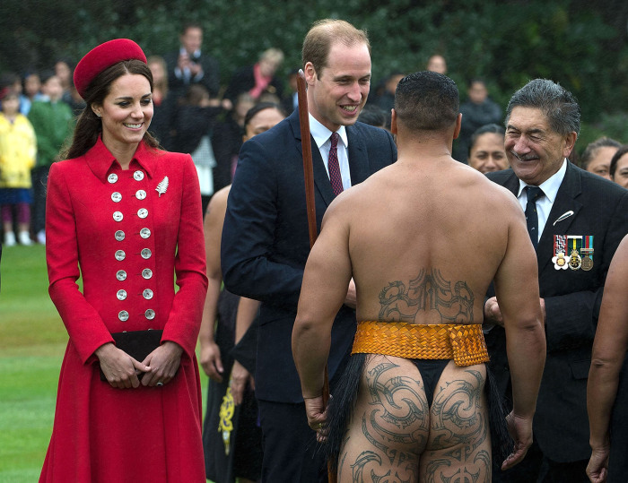 TOPSHOTS  Britain's Prince William (C) and his wife Catherine (L) meet a Maori warrior during a welcoming ceremony at Government House in Wellington o...