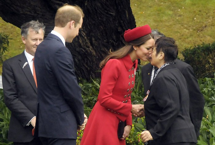 Britain's Prince William (2nd L) watches as his wife Catherine, Duchess of Cambridge, receives a Maori welcome known as a 'Hongi' at a traditional Mao...