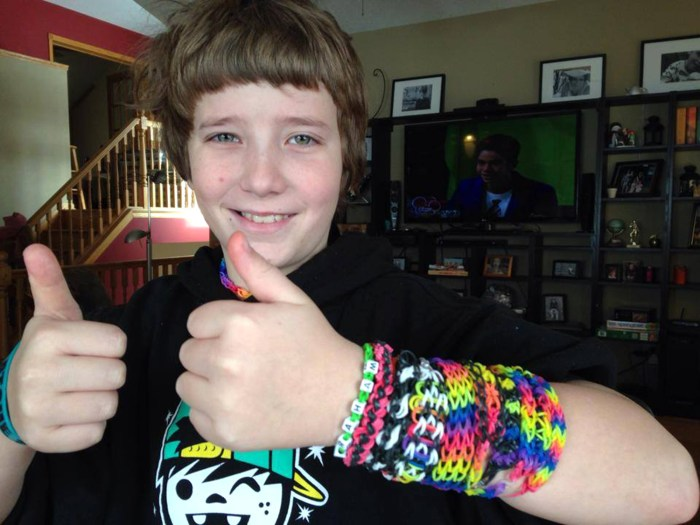 Graham Fowler, 10, shows off his handmade bracelets that he sells on Facebook to raise money for cancer.