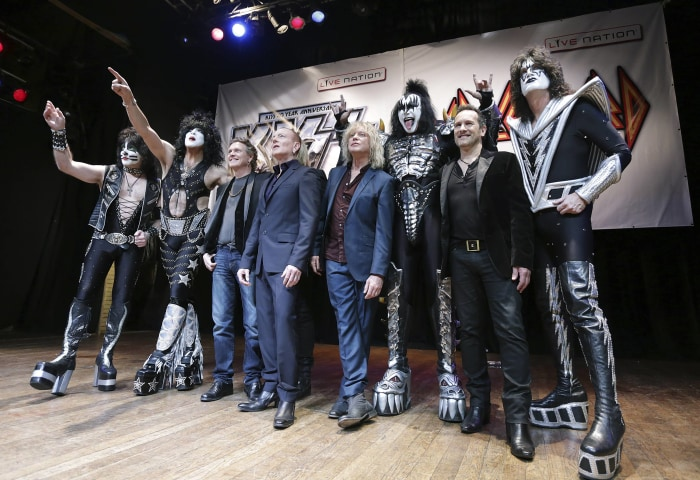 Members of KISS and Def Leppard pose during an announcement that the bands will team up this summer for a 42-city North American tour, at the House of...