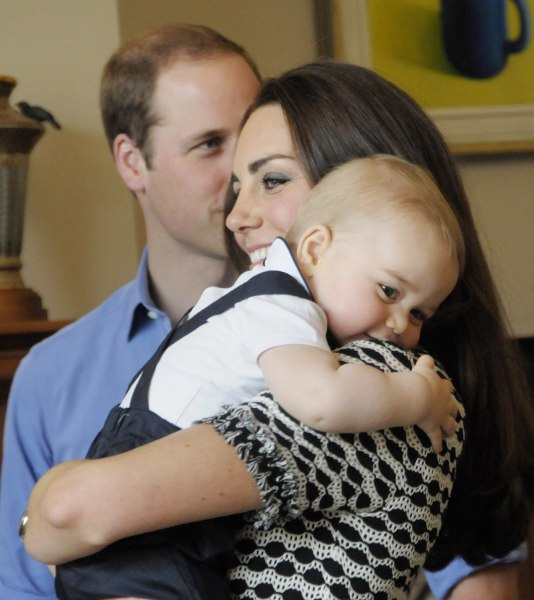 This handout photo taken on April 9, 2014 and provided by Woolf / Crown Copyright shows Britain's Prince George being held by his mother, Catherine, t...