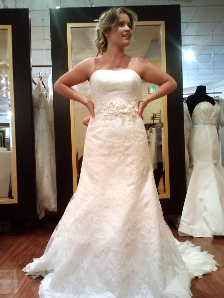 Cays tries on a wedding gown she eventually purchased, and had stolen.