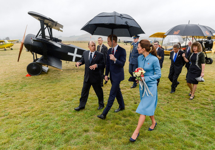 Britains Prince William and Catherine, Duchess of Cambridge get a tour from Graham Orphan (L) at the Omaka Aviation Heritage Centre, Blenh...