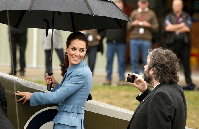 Britain's Catherine (L), the Duchess of Cambridge, is photographed by New Zealand film director Peter Jackson (R) as she stands next to a Sopwith Pup ...