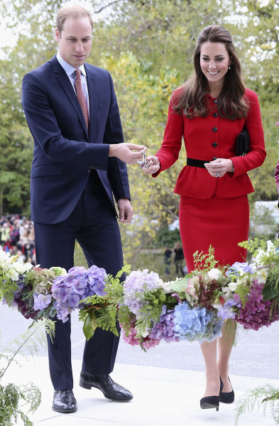 "Catherine, Duchess of Cambridge, and her husband Britain's Prince William prepare to cut a ""flower ribbon"" as they officially open the Visitor's Centre at the Botanical Gardens in Christchurch, New Zealand."