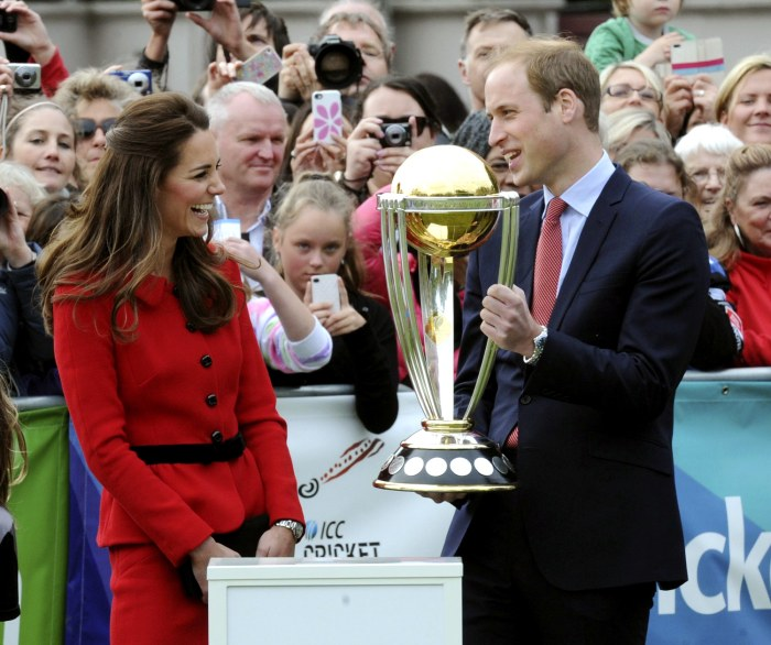 Prince William holds the Cricket World Cup trophy as Duchess Kate  smiles during a promotional event at Latimer Square during their visit to Christchurch, New Zealand, on Monday.
