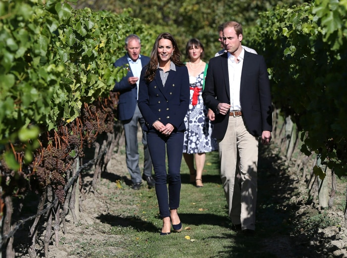 epa04165677 Britain's Prince William and Catherine, Duchess of Cambridge, walk in a vineyard as they visit the Amsfield Winery in Queenstown, New Zeal...