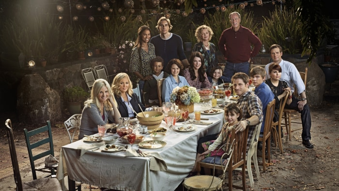 "The ""Parenthood"" cast sits in the grandparents' magical outdoor dining area."