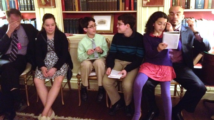 Kid reporters wait in the White House library to speak to the first lady.