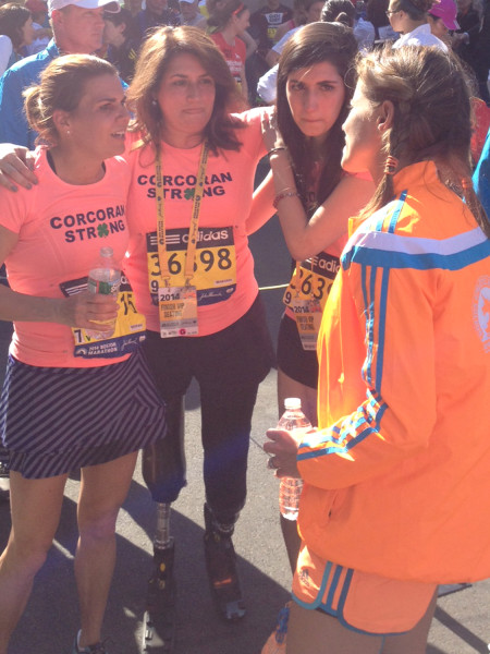 Celeste and Sydney Corcoran joined Carmen Acabbo at the finish line for the Boston Marathon on Monday, a year after the bombing that claimed both of Celeste's legs and left them with injuries.