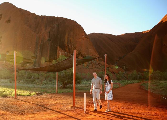 AYERS ROCK, AUSTRALIA - APRIL 22:  Catherine, Duchess of Cambridge and Prince William, Duke of Cambridge walk down Kuniya Walk at the base of Uluru on...