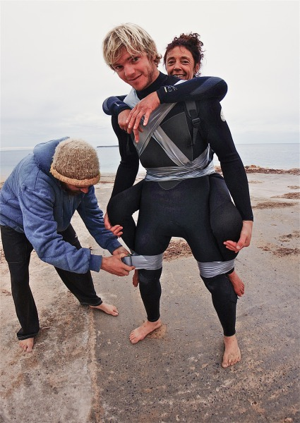 The duct-tape method that lets the pair ride the waves together.