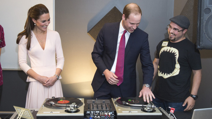 ADELAIDE, AUSTRALIA - APRIL 23:  Catherine, Duchess of Cambridge looks on as Prince William, Duke of Cambridge is shown how to play on DJ decks at the...