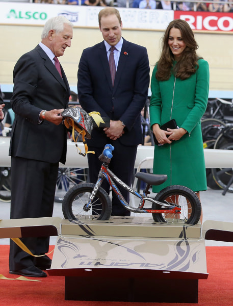 Prince William and Duchess Kate are presented with an Avanti mini bike for Prince George.
