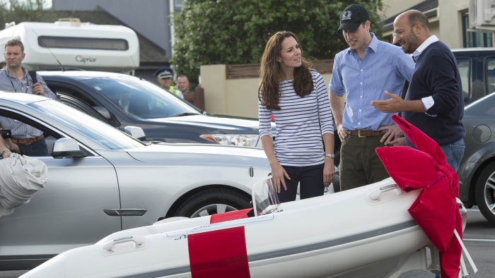 Duchess Kate and Prince William look at an amphibious boat presented to them for their son Prince George in Auckland, New Zealand on April 11, 2014.