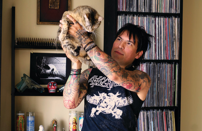 "Photo of Dav Tafoya and Ghidora the cat from ""Metal Cats"" by Alexandra Crockett, published by powerHouse Books."