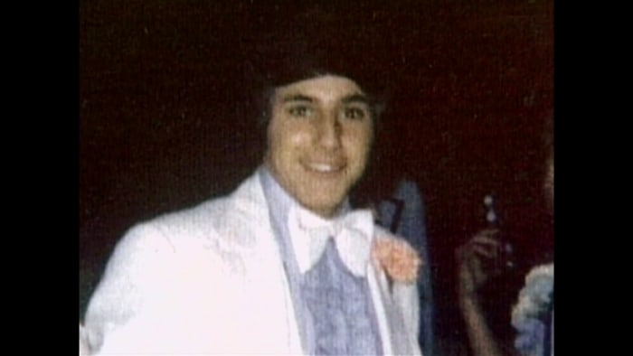 Matt in a snazzy white tux at his prom.