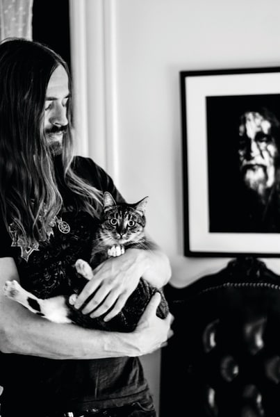 Brett Hanson of the band Evil Slime is pictured with his cat, Abigail.