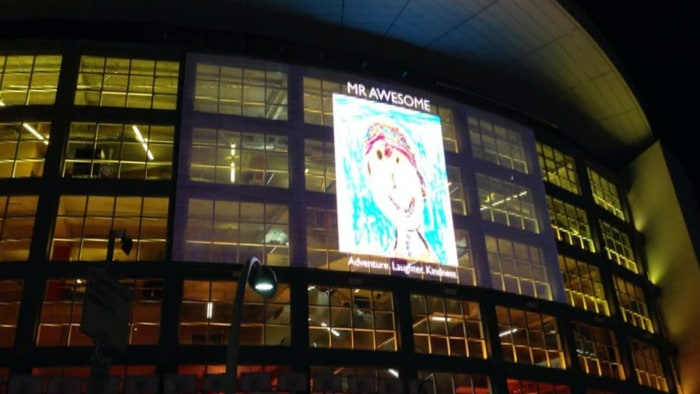 "The ""Mr. Awesome"" self portrait drawn by Calder Sloan appeared on the side of American Airlines Arena, the home of the defending NBA champion Miami Heat."