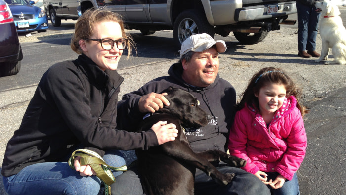 From left, Christine Davies, Greg Mahle, Lylia Davies with Niles the dog.