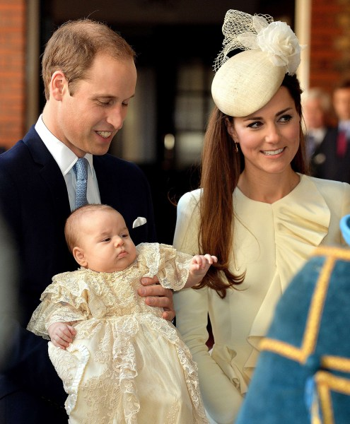 TOPSHOTS Britain's Prince William, Duke of Cambridge and his wife Catherine, Duchess of Cambridge, arrive with their son Prince George of Cambridge at...
