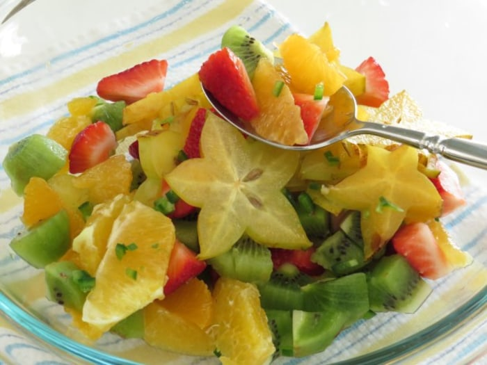 Tropical fruit salad with sweet and spicy dressing
